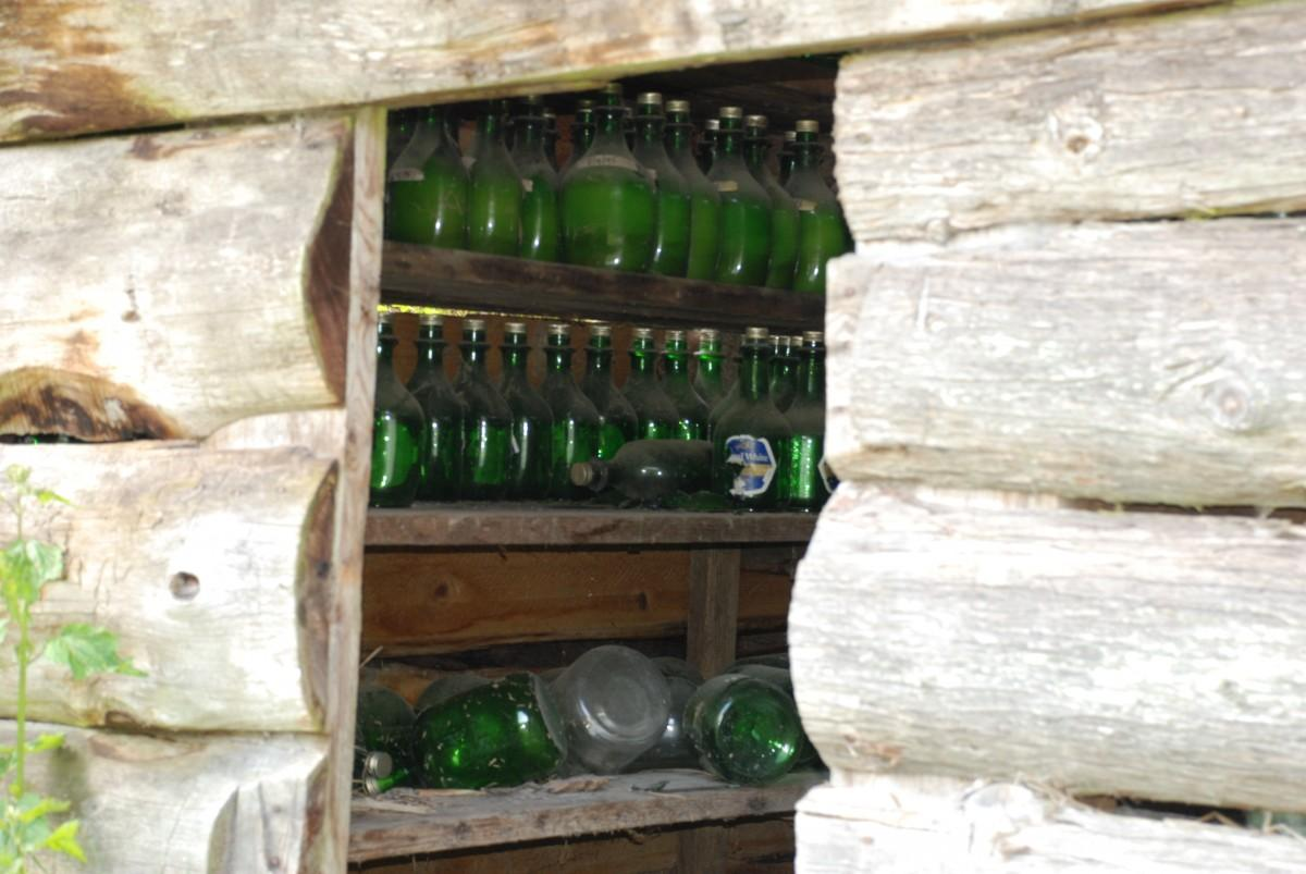 A grease shack stocked with bottles of Eulachon grease