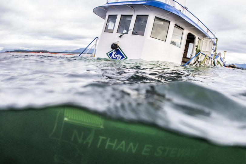 Split shot showing Nathan E. Stewart above and below water after running around in Heiltsuk territory