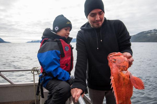 Kitasoo/Xai'Xais' Vernon Brown contemplatingBrock a yelloweye rockfish