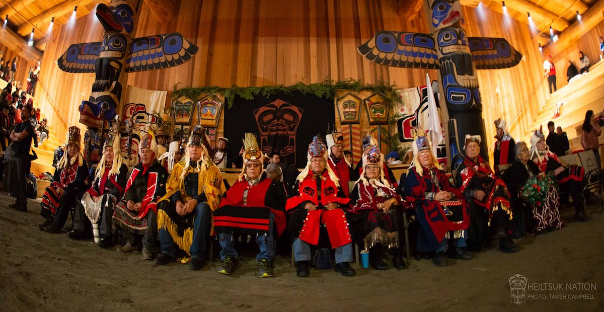 Heiltsuk Nation elders in regalia sitting in the new Big House
