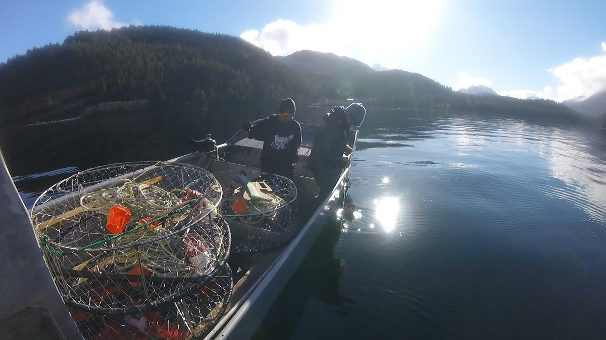 Heiltsuk Guardian Watchmen on the boat collecting traps for crab surveys.